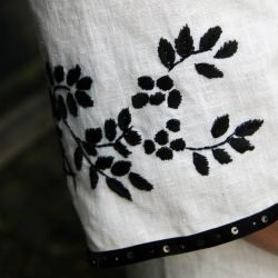 White short hand embroidered linen open back dress
