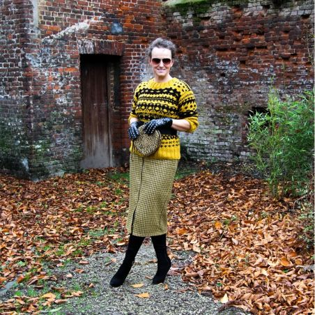 Knitted mustard sweater in a nordique style