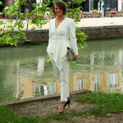 Woman ivoire asymmetrical wedding peplum jacket